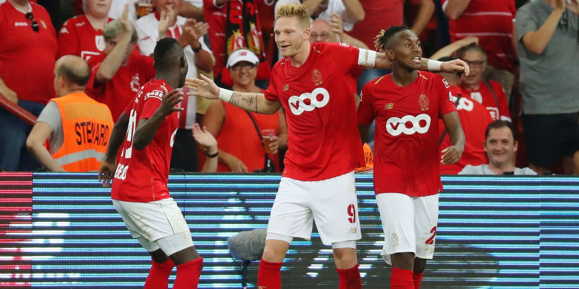 Standard's Moussa Djenepo and Standard's Renaud Emond celebrate after scoring during the Jupiler Pro League match between Standard de Liege and KAA Gent, in Liege, Friday 27 July 2018, on the first day of the Jupiler Pro League, the Belgian soccer championship season 2018-2019. BELGA PHOTO VIRGINIE LEFOUR