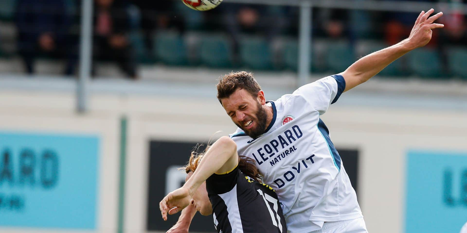 Lokeren's Guus Hupperts and Virton's Manuel Angiulli fight for the ball during a soccer match between Royal Excelsior Virton and KSC Lokeren, Sunday 08 September 2019 in Virton, on day five of the 'Proximus League' 1B division of the Belgian soccer championship. BELGA PHOTO BRUNO FAHY