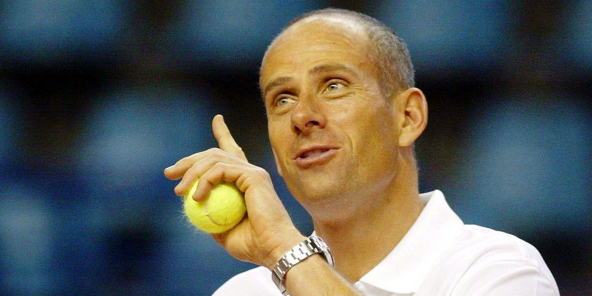 epa00686854 French Davis Cup team captain Guy Forget makes a point during the tennis Davis Cup training session in Pau, France, Thursday, 06 April 2006. France will play against team Russia in the quarterfinals on weekend. EPA/JEAN-LOUIS DUZERT